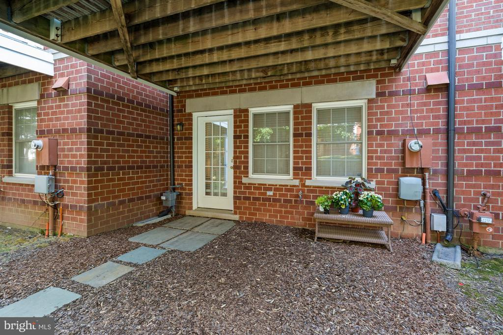 Lower Level Exterior Perfect for Planting - 12079 CHANCERY STATION CIR, RESTON