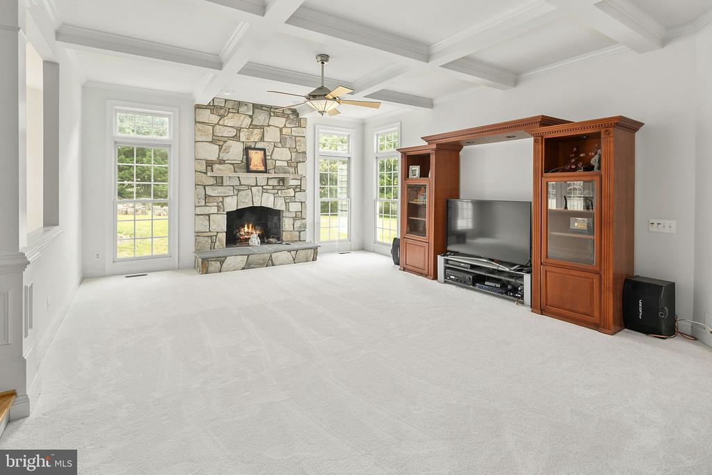Family room with gas fireplace and stone hearth - 2792 MARSHALL LAKE DR, OAKTON