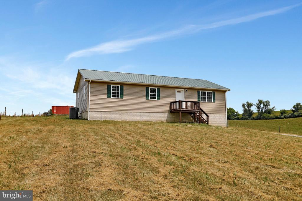 Rancher sits in the middle of the property. - 857 MT HAMMOND, CHARLES TOWN