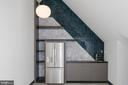 Loft wet bar with floating shelves - 1120 GUILFORD CT, MCLEAN