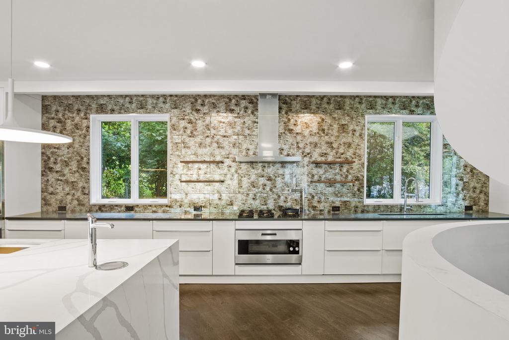 Modern Kitchen with glass tile backsplash� - 1120 GUILFORD CT, MCLEAN