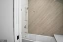 Frameless glass door over tub - 1120 GUILFORD CT, MCLEAN
