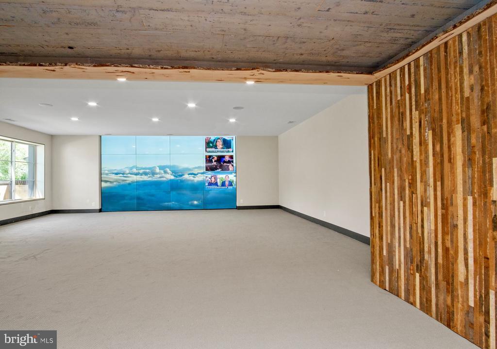 Open basement entertainment space - 1120 GUILFORD CT, MCLEAN