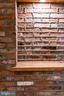Reclaimed brick wall and niche - 1120 GUILFORD CT, MCLEAN
