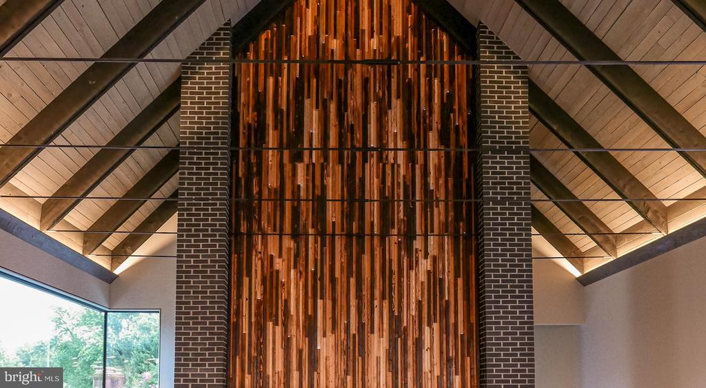 Fireplace wall centered in cathedral ceiling - 1120 GUILFORD CT, MCLEAN
