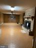 Family room with brick fireplace - 704 APPLE PIE RIDGE RD, WINCHESTER