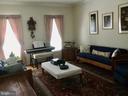 Formal living room with gleaming wood floors - 8300 MUSKET RIDGE LN, FREDERICKSBURG