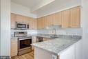 Updated kitchen has granite counters - 19365 CYPRESS RIDGE TER #816, LEESBURG