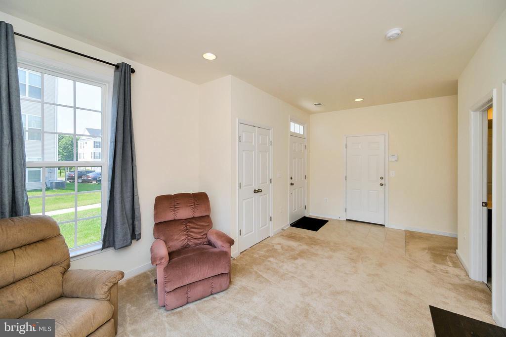 Lower Level entrance door & garage door - 114 THRESHER LN #18, STAFFORD