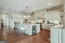 Large Center Island with Wine Refrigerator - 15830 SPYGLASS HILL LOOP, GAINESVILLE