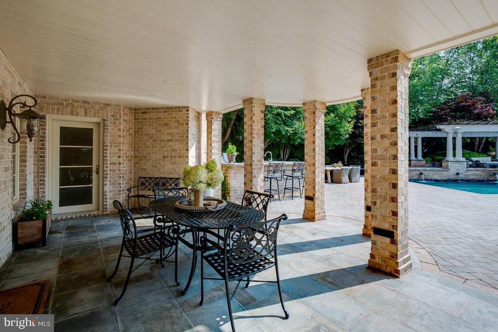 Lovely Covered Patio off of the Pool House - 15830 SPYGLASS HILL LOOP, GAINESVILLE