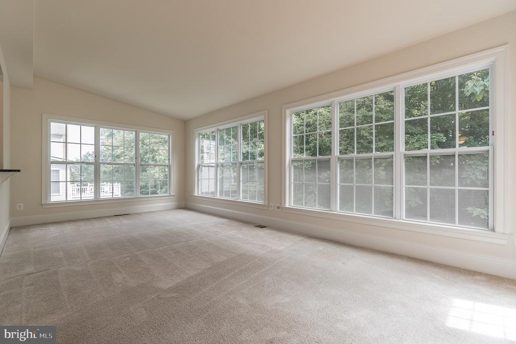 Sun Room Looking out on the wooded back yard. - 3336 DONDIS CREEK DR, TRIANGLE