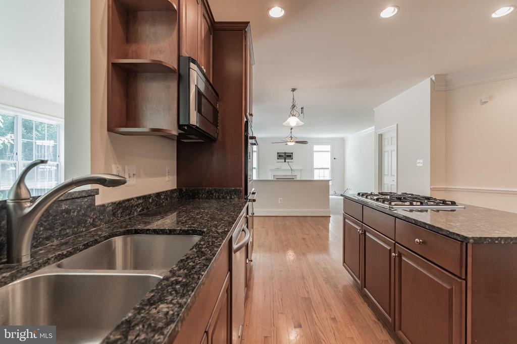 The OPEN view from the Kitchen to Living Rm. - 3336 DONDIS CREEK DR, TRIANGLE