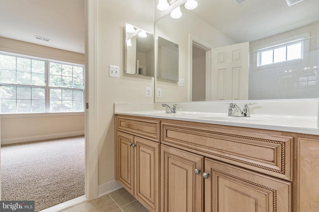 Jack and Jill Bath facing rear BR - 3336 DONDIS CREEK DR, TRIANGLE