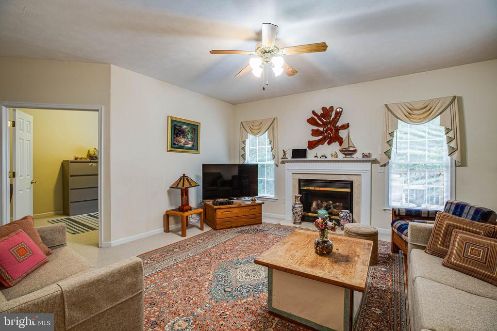 Gas fireplace in the family room - 8300 MUSKET RIDGE LN, FREDERICKSBURG