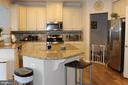 Kitchen with stainless appliances - 17105 SEA SKIFF WAY, DUMFRIES