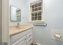 Half Bath at Garage Entrance - 16201 DUSTIN CT, BURTONSVILLE