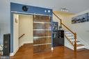 Smart barn door leads to private garage access - 1418 N RHODES ST #B-112, ARLINGTON