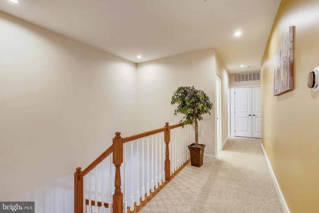 Carpeted upstairs hallway with recessed lighting - 1418 N RHODES ST #B-112, ARLINGTON