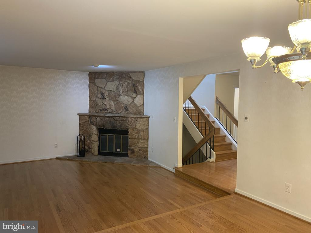 Stone living room fireplace - 11605 CLUBHOUSE CT, RESTON