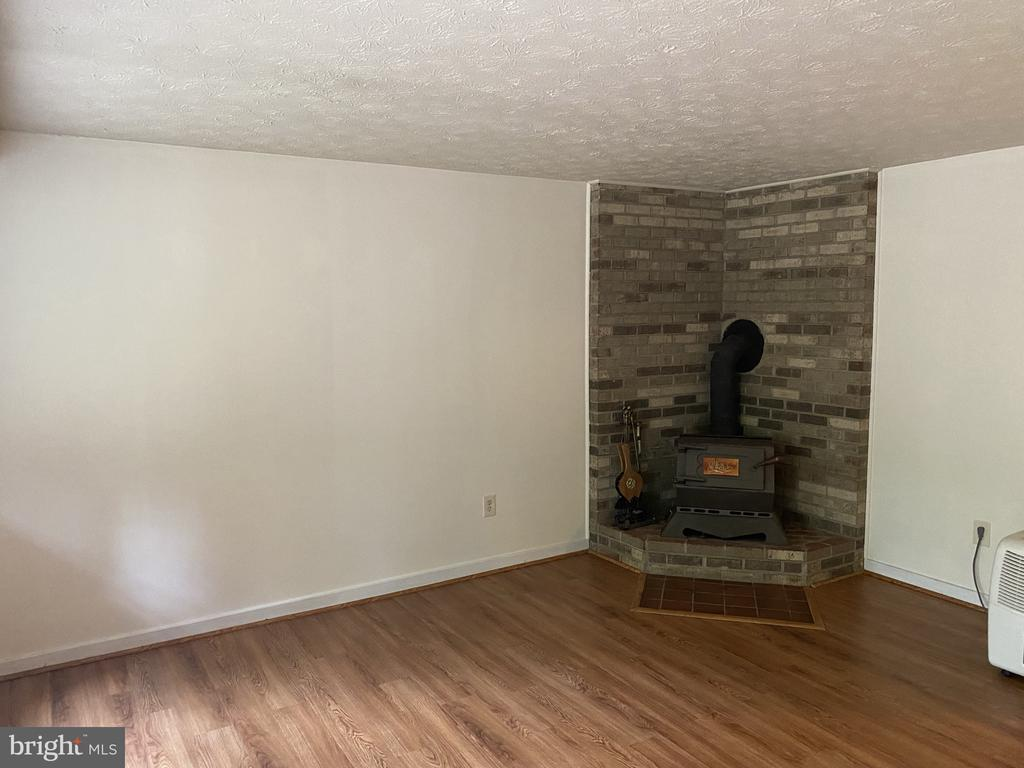 Recreation room wood stove - 11605 CLUBHOUSE CT, RESTON