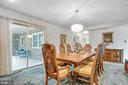 Sliding glass doors to enclosed back porch - 8927 BURBANK RD, ANNANDALE