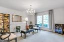 Living Room with Chair Rail Molding and Chandelier - 8927 BURBANK RD, ANNANDALE