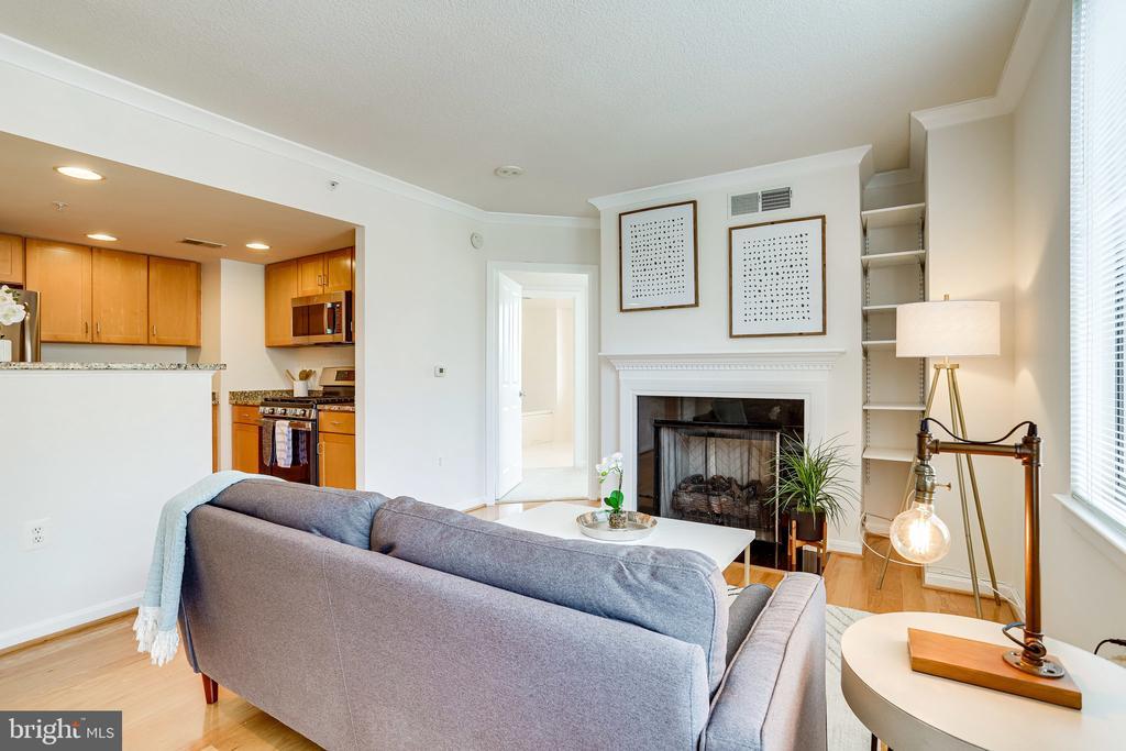 Open floor plan and cozy gas fireplace. - 2220 FAIRFAX DR #803, ARLINGTON