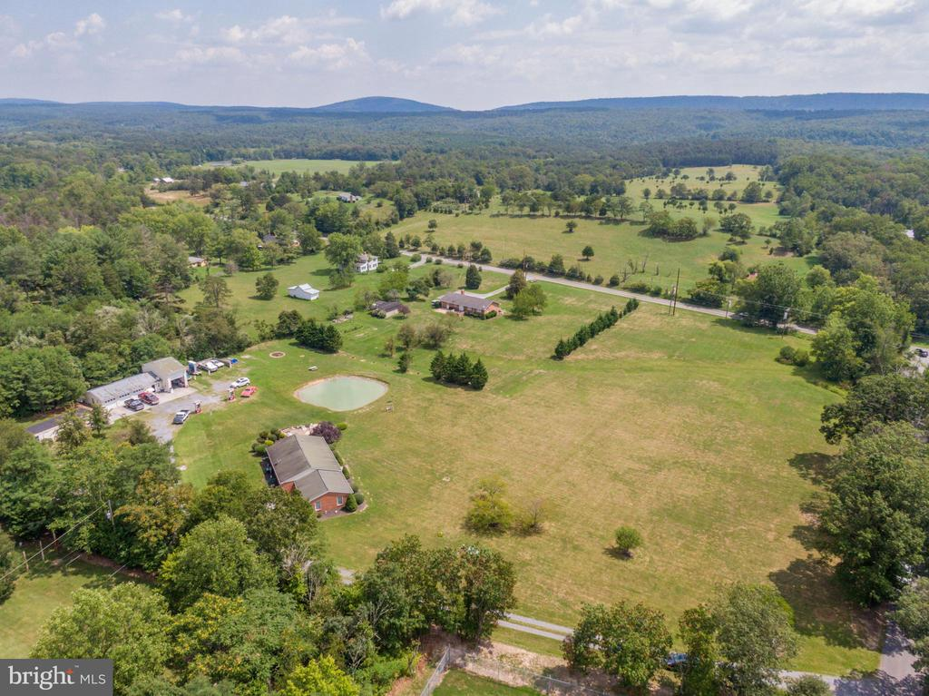 Drone view of beautiful trees & mountain surround - 140 BOWMAN LN, WINCHESTER