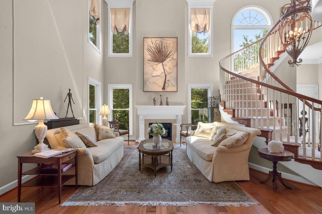 Two-story Living  w wall of windows  & fireplace - 20260 ISLAND VIEW CT, STERLING