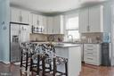 Well-equipped kitchen boasts a large island - 22469 VERDE GATE TER, BRAMBLETON