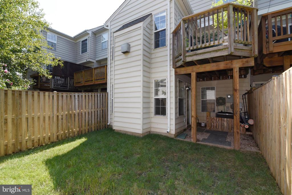 REAR VIEW OF ELEVATED DECK - 112 CONNERY TER SW, LEESBURG