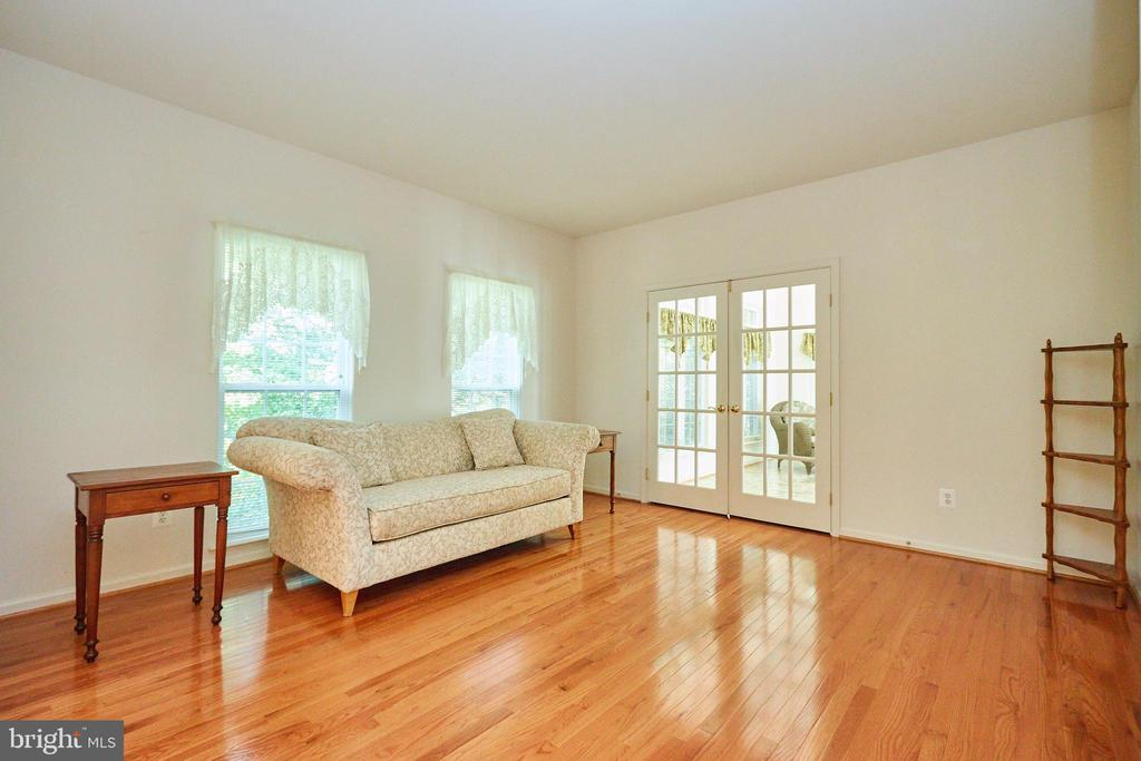 Sitting room with French doors to the sunroom - 619 BRECKENRIDGE WAY, SHENANDOAH JUNCTION