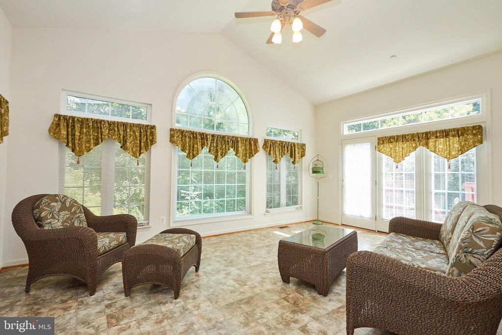 Sunroom off the sitting room with deck access - 619 BRECKENRIDGE WAY, SHENANDOAH JUNCTION