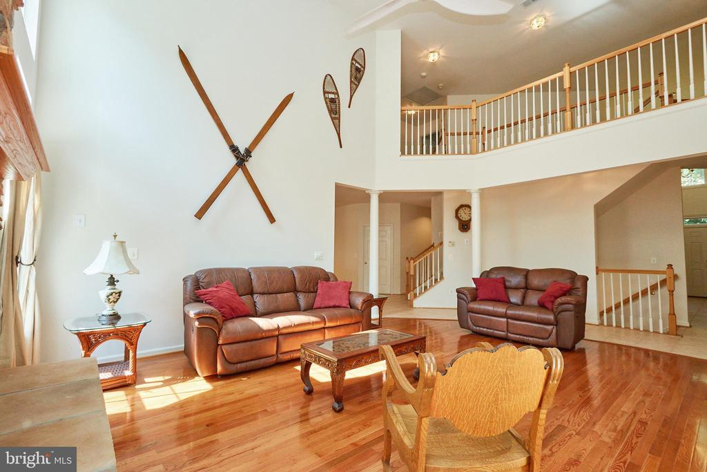 Two story family room off the large open hallway - 619 BRECKENRIDGE WAY, SHENANDOAH JUNCTION