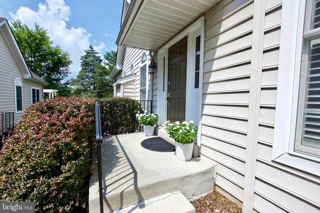 Main entrance is on the side of the Carriage Home - 25659 TREMAINE TER, CHANTILLY