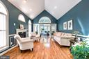 Living Room has cathedral ceilings & French doors - 25659 TREMAINE TER, CHANTILLY