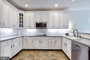 White cabinets, subway tile backsplash - 25659 TREMAINE TER, CHANTILLY