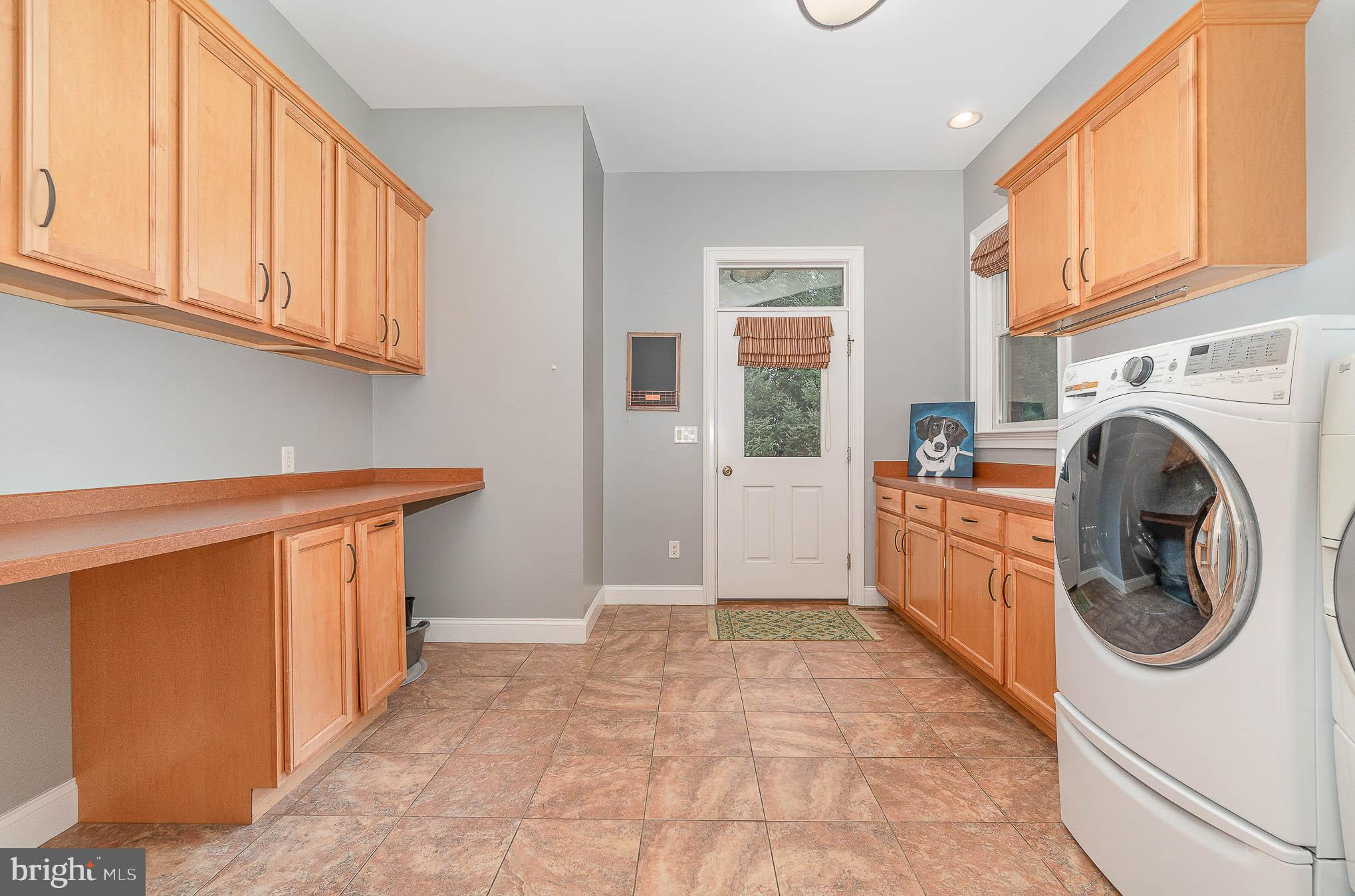 Large laundry room/mud room with separate entrance