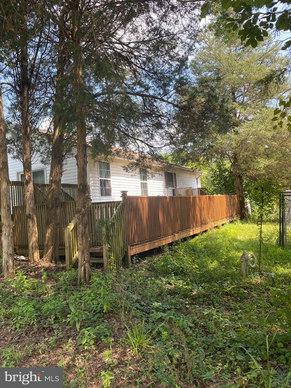 Large deck on side of home - 22313 EVERGREEN MILLS RD, LEESBURG