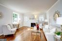 The main LL boasts a living room w/ wood fireplace - 6112 WOODMONT RD, ALEXANDRIA