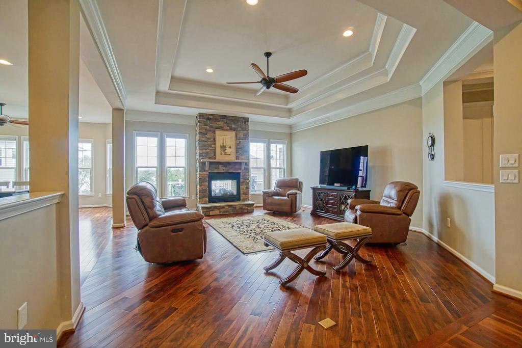 Family room/den with gas fireplace - 16604 FOX CHASE CT, LEESBURG