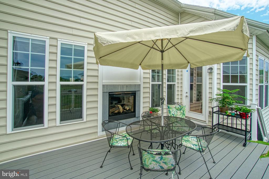 Back deck with fireplace - 16604 FOX CHASE CT, LEESBURG