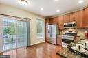 Stunning kitchen with HW floors opens to deck! - 25146 DRILLFIELD, CHANTILLY