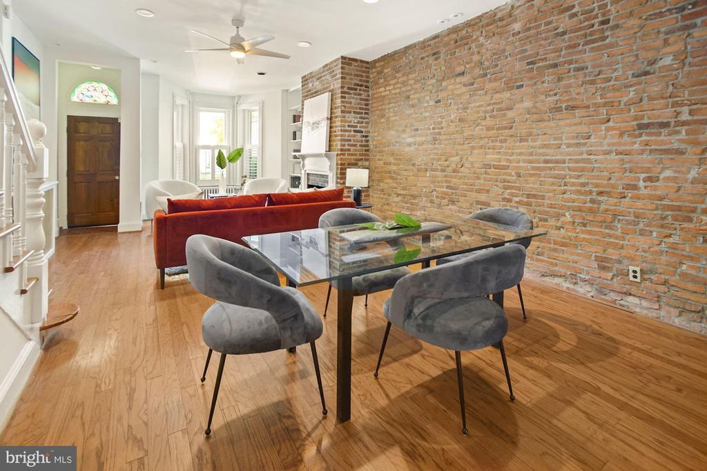 Exposed brick + hardwood floors. - 321 F ST NE, WASHINGTON