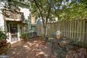 Tree covered bi-level brick patio. - 321 F ST NE, WASHINGTON