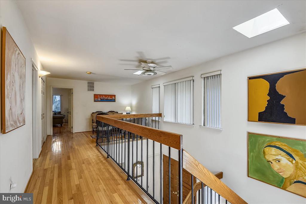 Upper level hallway open to below - 10722 CROSS SCHOOL RD, RESTON