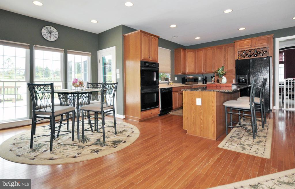 Large eating area off kitchen w/hardwood flooring. - 15305 LIONS DEN RD, BURTONSVILLE
