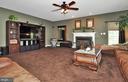 Loads of windows, corner wood stove & ceiling fan. - 15305 LIONS DEN RD, BURTONSVILLE