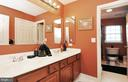 Hallway bath with double vanity & access from bed. - 15305 LIONS DEN RD, BURTONSVILLE